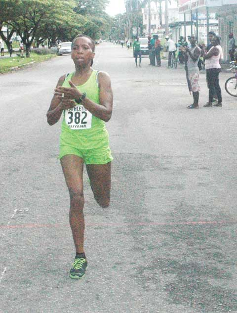 Euleen crosses the finish line during the 2013 Athletics Association of Guyana Annual Independence Half Marathon