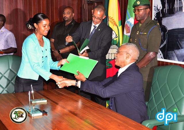 Eighteen year old Maxine Ann Welch, the Deputy Mayor of Lethem, Upper Takutu- Upper Essequibo (Region Nine) receiving her Instrument of Appointment from President David Granger.