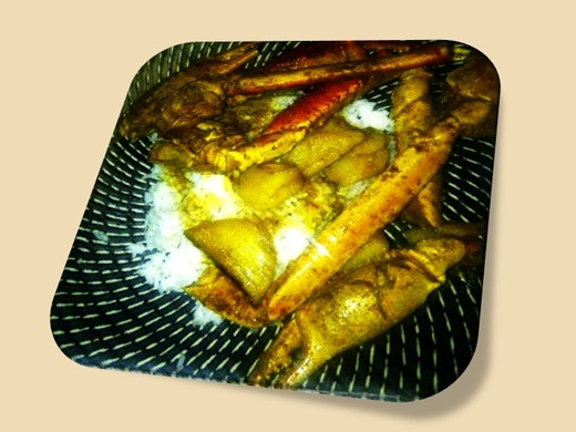 Curried king crab legs with potatoes, served on fluffy white rice