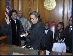 Judge Pam Jackman- Brown being sworn in by Judge Fern Fisher