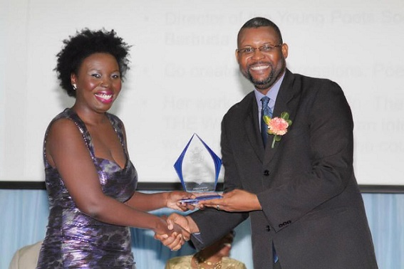 Linisa George receiving a Literary Arts Award