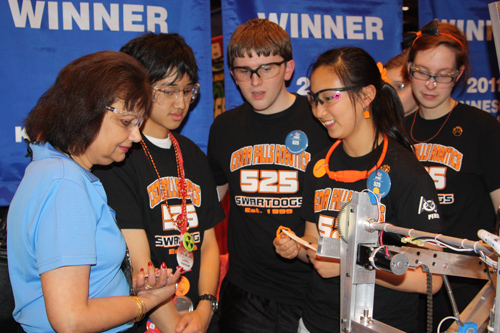 Rockwell Collins Senior VP Nan Mattai, talks to the Swartdogs team during the 2012 FIRST World Championship, Science & Technology competition.