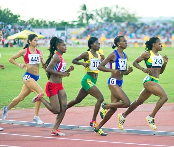 Marian Burnett leading the pack during the 1500m at the 2010 CAC Games in Puerto Rico