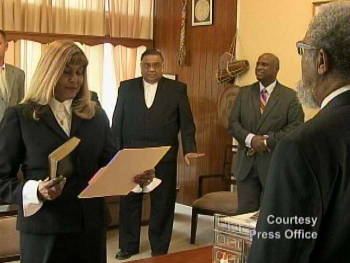 Justice Hafiz-Bertram being sworn in.