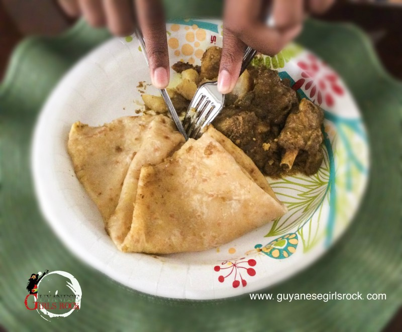 Eating curry and roti with a fork (photo re-enacted)