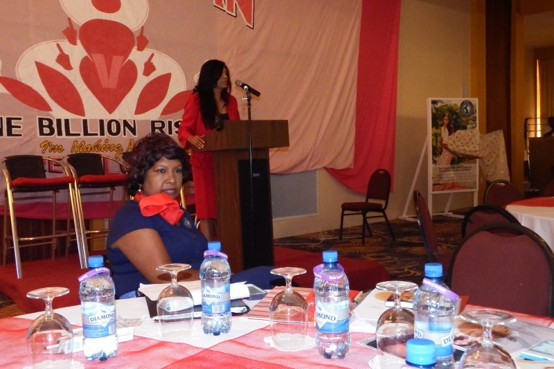 Sukree listening attentively as fellow advocate, Dianne Madray, address the room at the One Billon Rising Let the Women Speak Luncheon in Guyana