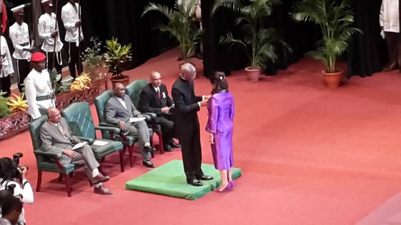 Supriya Singh-Bodden receiving Cacique Crown Of Honor from President Granger