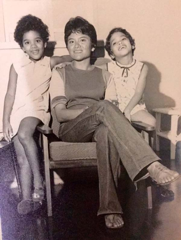 a young Afuwa and her sister, with their mother, Sandra Granger.